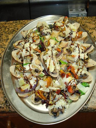 New Providence, Nueva Jersey: Kicked up bruschetta with grilled veggies and shaved parmesan!
