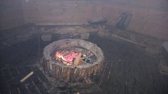 Viitasaari, Finlandia: A place (inside) with a fireplace to bbq your sausages. The sticks to put them on are there alre
