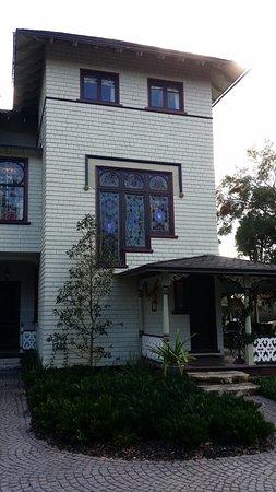 DeLand, FL: John B. Stetson Mansion side view of porch main entry