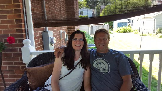 Between the Maples: Sitting on the incredible covered gazebo on the front deck of the home.