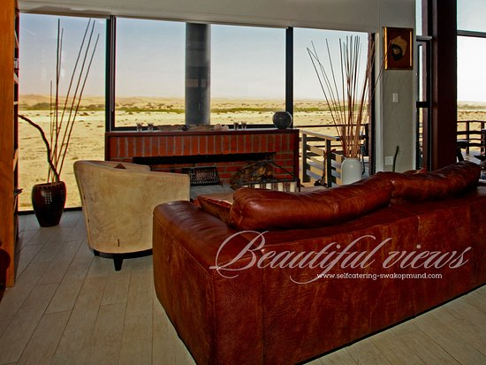 Duenenblick Selfcatering Apartments : Lounge with fireplace in Boutique with spectacular view over the Dunes