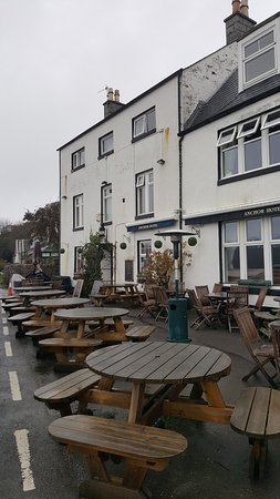 Kippford, UK: Our frontage is to the sea  with just the lane and the sea wall between us -