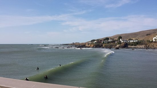 Cayucos, CA: surfers from the pier