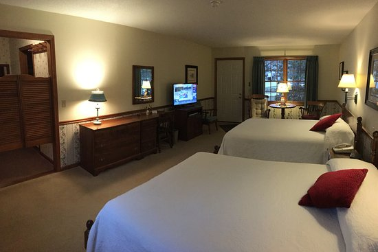 Manchester, VT: Deluxe room with two queens, dressing room, sitting area, and refrigerator.