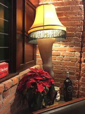 the vintage tavern hilarious christmas story leg lamp and bb gun on