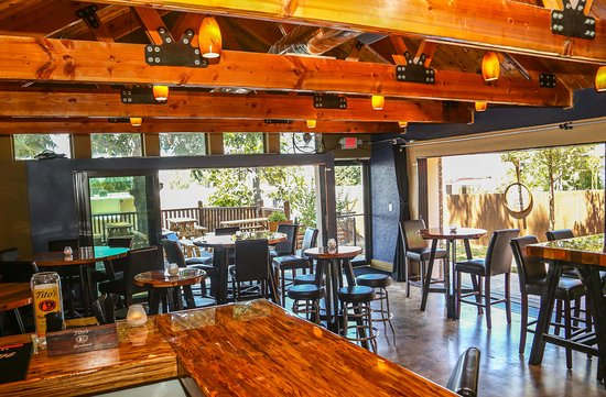 restaurant interior going to outdoor patios picture of revelry