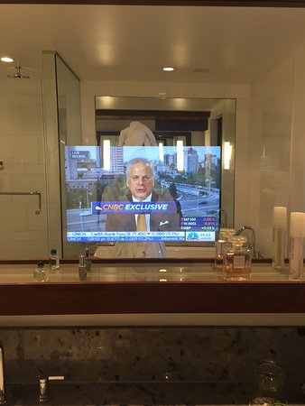 Fairmont Pacific Rim: watching CNBC while getting ready