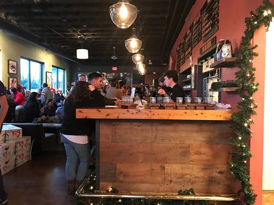 Frederick, MD: Busy bar - pulling knobs, filling growlers and crowlers.