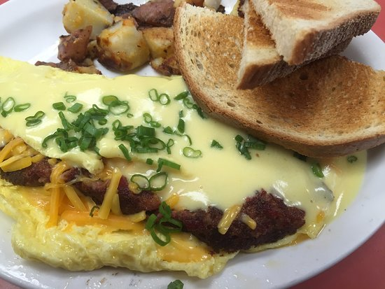 Turtle Cafe: Woodie Omelette: Hash & Cheddar Omelette topped with hollandaise sauce and scallions!