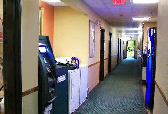 McLean, IL: hall look. canned-soda machine, ice, washer/drier, atm just outside office/breakfast area