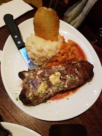 Connolly's Pub & Restaurant: New York strip was tasty but overcooked