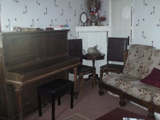 Colne, UK: Relax in our TV/sitting room or come and play the communial piano