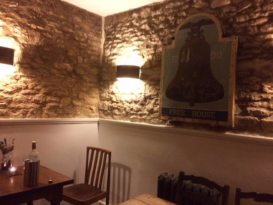 Charlbury, UK: inside the restaurant with the original 'Bell' sin on the wall