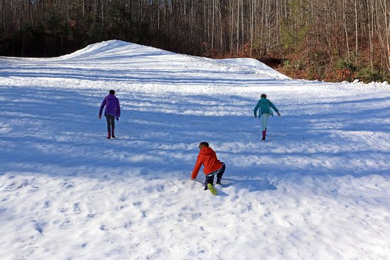 "Tube World: Playing on the ""hill"" in the snow"