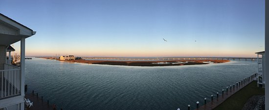 Hampton Inn and Suites Chincoteague-Waterfront: Panoramic early-morning view from room 306, looking west over Chincoteague Channel.