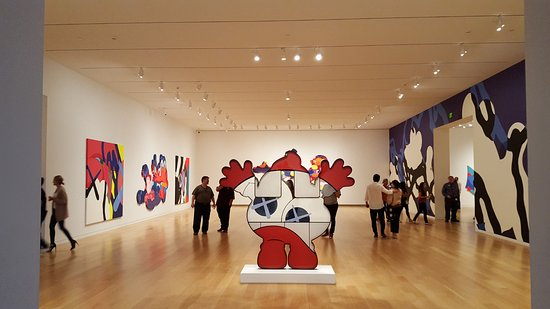 View Of A Room Full Of Kaws Art Picture Of Modern Art