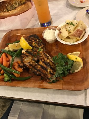Blacken grouper, jumbo shrimp stuffed with crab meat and conch fritters