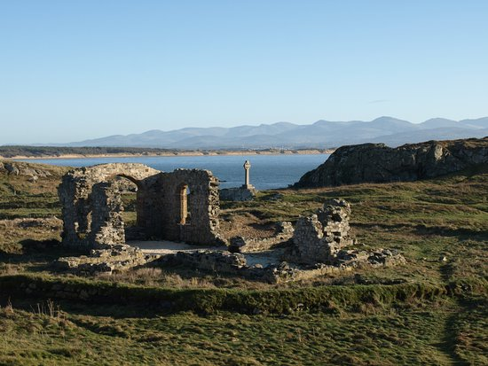 "Newborough, UK: The church of St. Dwynwen"". She is the Welsh patron saint of lovers, making her the Welsh equiva"