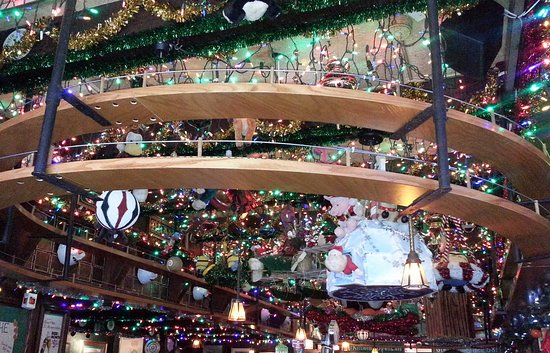 butch mc guires tavern double levels of train track amidst christmas decorations over the bar - Chicago Christmas Decorations
