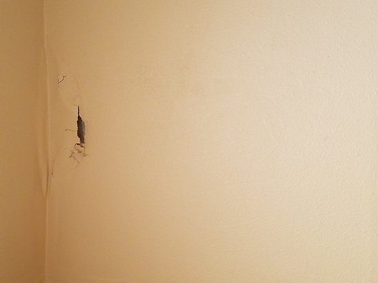 Hazelwood, MO: This the wall in the bathroom. There had been a leak at some point so the paint and plaster were