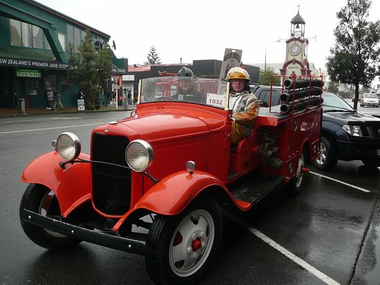 this 1932 Fire Engine was out in Hokitika with the Clock tower behind it. -  Picture of Westland Industrial Heritage Park, Hokitika - Tripadvisor