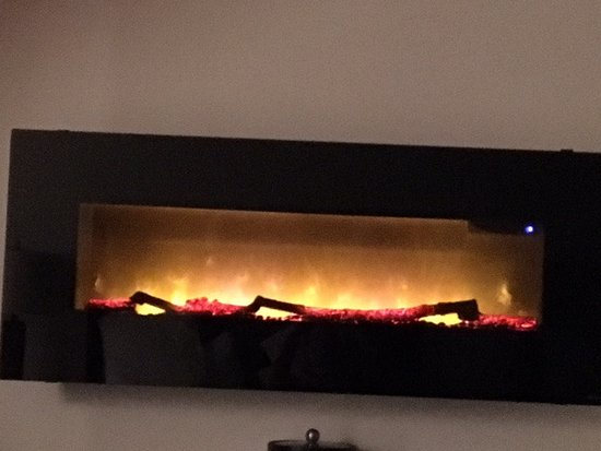 "Sea & Sand Inn: Picture of our ""fireplace"". Cozy touch"