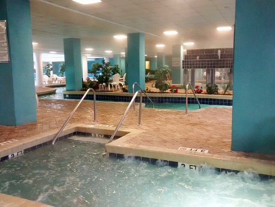 Indoor Pool Area One Of The 5 Indoor Hot Tubs With Lazy River In Background Picture Of Landmark Resort Myrtle Beach Tripadvisor