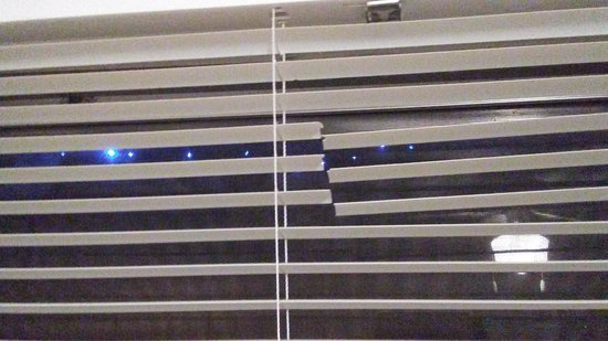 Rainbow Rivers Club: Broken blinds.