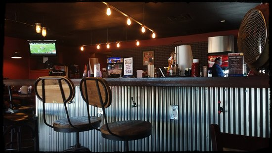 Forrest City, AR: Nice ambiance and comfortable seating for watching a game. Bar service and USB charging stations