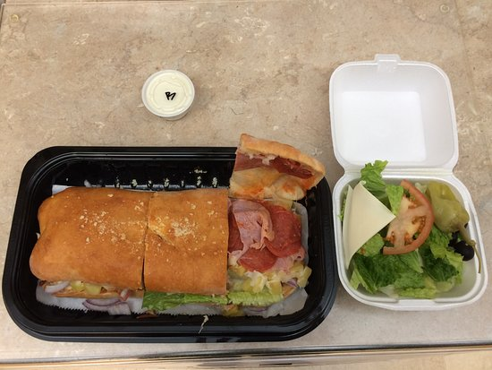 Wasilla, AK: Tuscan Pizza's Hot Italian Sub w/side salad and dressing - even better tasting than it looks!