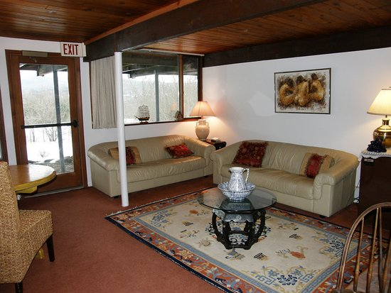 Stephentown, NY: One of our common rooms with fireplace and trunk full of games.