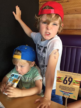 Botany Downs, New Zealand: Kids happy with their BF tattoo's and full belly's