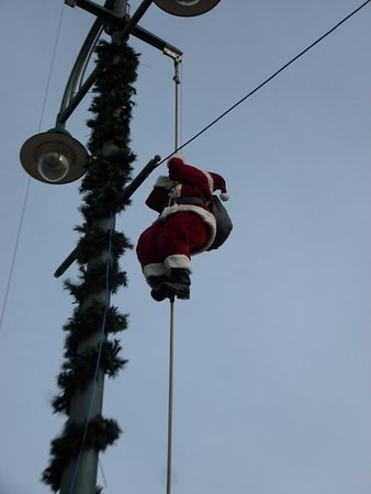 The Square: Father Christmas Climbing up a rope
