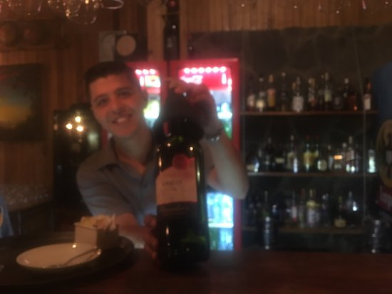 Tramonti: Bartender showing my wife his house red wine