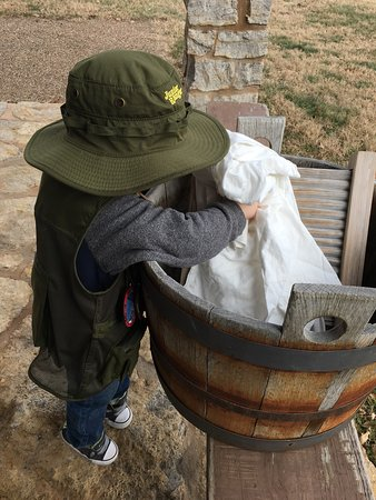 Fort Scott, KS: My Junior Ranger learning how to use a washboard!