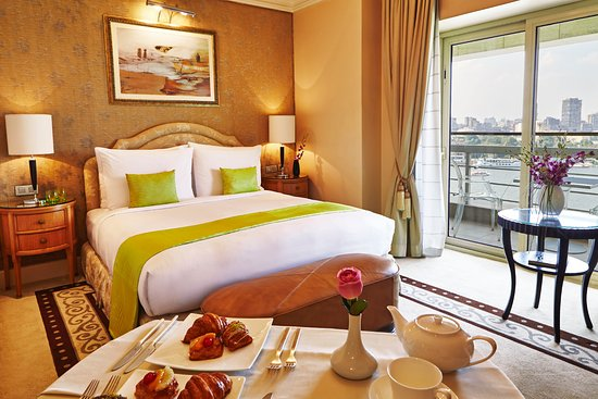 Kempinski Nile Hotel Cairo : Nile Deluxe room with a balcony to enjoy the panoramic view of the Nile