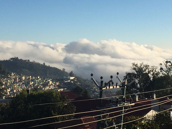 Villa Retreat: Kodai city view on a regular day with excellent flavor of the clouds