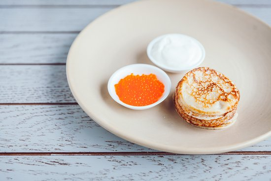 International: Pancakes with lightly salted local trout caviar | eco-ponds Pērtnieki | and sour cream