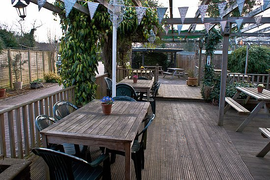 Capel, UK: Sit outside on the patio in warmer weather
