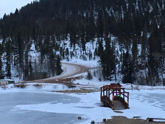 Red Feather Lakes, CO: One of the frozen ponds available for skating (bridge lit up at night).