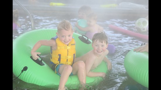 Sweet, ID: Adventurous grandsons sharing a tube