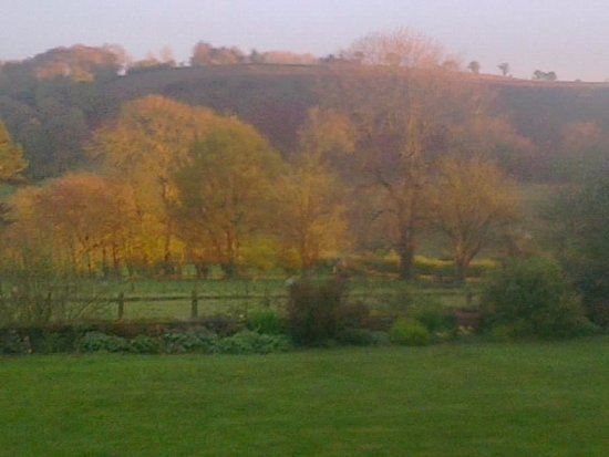 Lastingham, UK: an Autumn view over the garden from the house
