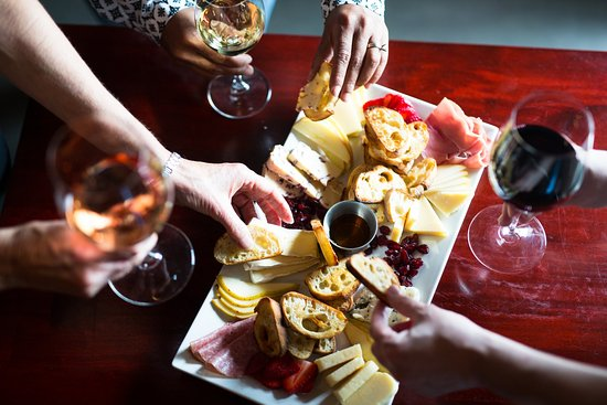 Red The Restaurant & Wine Boutique: Cheese Platter selections featuring local farm cheeses.