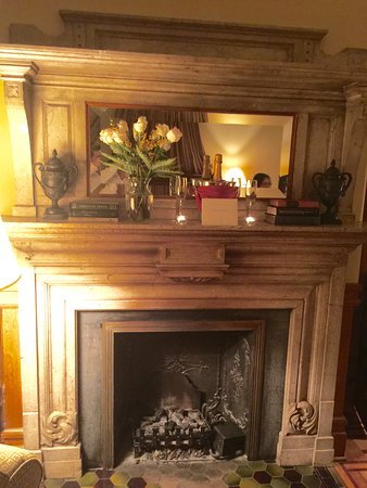 Wentworth Mansion: Fireplace with champagne and flowers---a very special extra touch!
