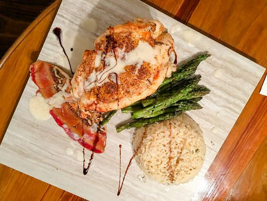 Lobster tail, asparagus and coconut rice at Last Chance Bar and Grill North Caicos, Turk