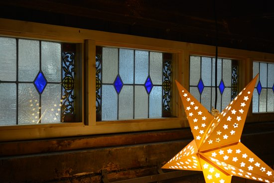 Andover, NH: One of the illuminated stars against the stained glass transom