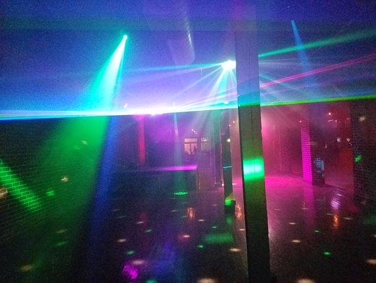 The Roaring Twenties Complex  Crazy lights on the second floor dance club.  The bartender c9876e7dd