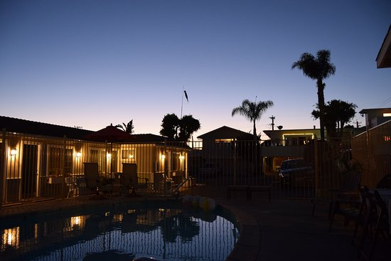 Shell Beach, CA: Enjoying a quiet beer by the heated pool at sunset.