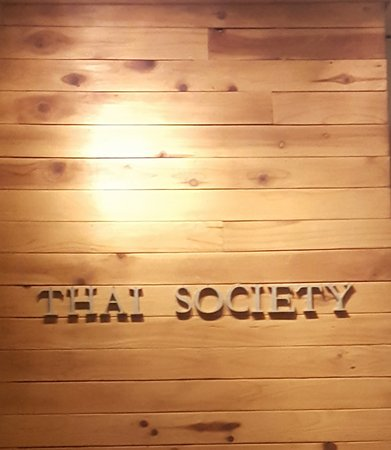 Thai Society: This is the back wall, there is a cute 3 stool bar in front of it