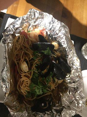 Gisburn, UK: Delicious food (scrumptious sea bass, seafood spaghetti and gnocchi with tomato sauce)